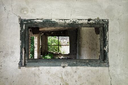 crumbling: Wooden weathered window frame and crumbling wall in abandoned building.