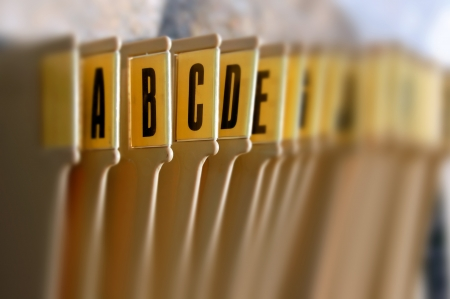 Alphabetical filing tray index office documents organizer. Selective focus. Imagens