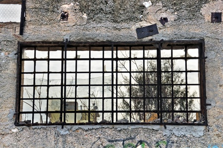 Concrete wall and view from broken window of abandoned factory. Stock Photo - 9217169