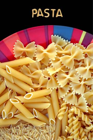 Dish with four kinds of italian pasta. Creative food background. photo