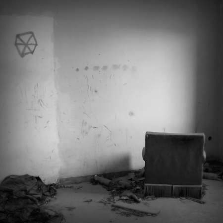 Armchair facing the wall in abandoned house. Black and white. Stock Photo - 9217040