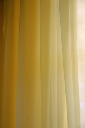 Transparent curtain background texture. Shades of yellow. Stock Photo - 9217044