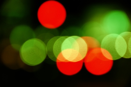 city lights: City traffic lights at night. Abstract blurry circles background.