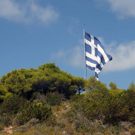 Gigantic greek flag on mountain top. Zakynthos, Greece. photo