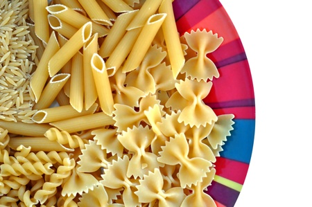Colorful plate with pasta variety. Creative food on white background. photo