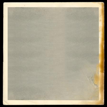 Vintage old blank burned photograph design element with white border.
