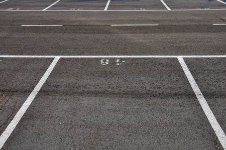 Dividing lines in empty asphalt paved parking lot abstract background. Stock Photo - 9420936