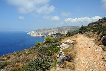 windswept: Windswept coastal ridges ionian sea and sky horizon. Keri lighthouse Zakynthos, Greece.