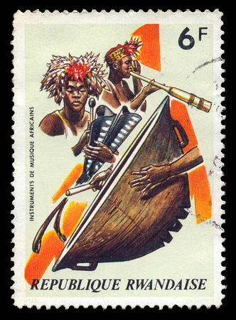 canceled: RWANDA - CIRCA 1973. Vintage canceled postage stamp with african musical instruments and traditional musicians illustration, circa 1973.