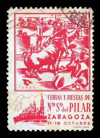 del: SPAIN - CIRCA 1930s. Vintage postage stamp for a fair and fiesta at the Basilica Cathedral de Nuestra Senora del Pilar in the city of Zaragoza with matador and cavaleiro bullfighting illustration, circa 1930s.