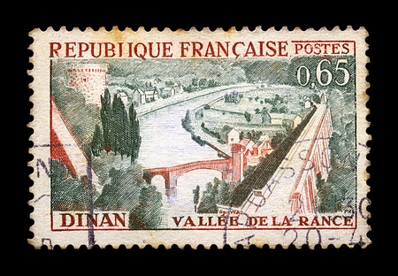 dinan: FRANCE - CIRCA 1963. Vintage canceled postage stamp with town of Dinan and river Rance illustration, circa 1963. Stock Photo
