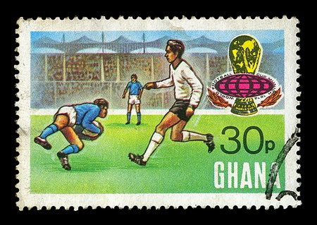 canceled: GHANA - CIRCA 1974. Vintage canceled postage stamp for the world football cup in Munich with soccer match in stadium illustration, circa 1974. Stock Photo