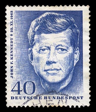 john: GERMANY - CIRCA 1964. Vintage postage stamp memorializes John F. Kennedy, circa 1964.