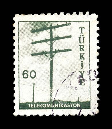 telephone pole: TURKEY - CIRCA 1960s. Vintage postage stamp with telephone pole telecommunications illustration, circa 1960.