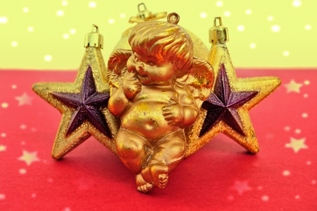 angel figurine: Cupid and golden stars baubles. Christmas decoration.
