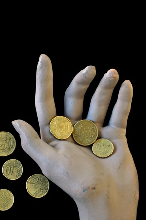 income market: Worn hand holding a few euro money coins. Economic and financial issues concept.