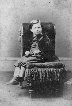 Portrait of boy on chair, black and white  Sourced from antique cabinet card vintage photograph created by A D  Lewis, Newcastle on Tyne, UK, circa 1870