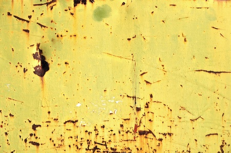 Chipped yellow paint on rusty iron  Metal texture industrial grunge background  photo