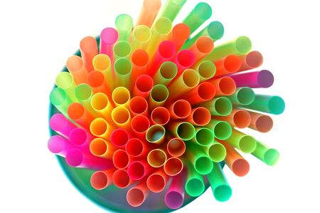 Colorful drinking straws on white background  photo