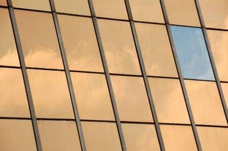 tinted: Sky reflected on glass facade panel of a modern building  Abstract background