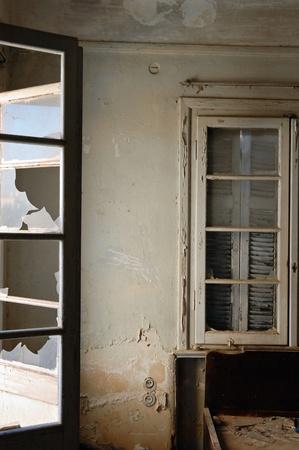 moldy: Broken door and windows in abandoned house interior. Stock Photo