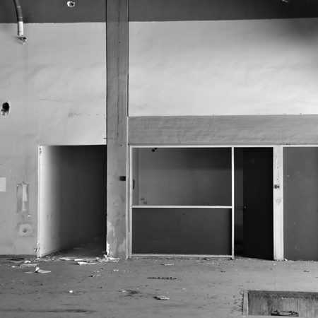 Empty room and concrete wall derelict factory interior. Black and white. photo