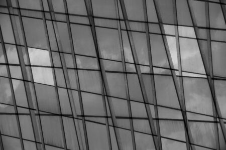 Modern building facade glass panel abstract double exposure. Black and white. photo