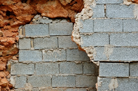 Broken stone and cinder block brick walls background texture  Stock Photo - 13547470