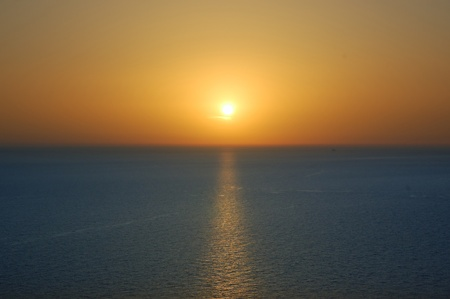 Sunset over water  Deep blue sea and orange colored sky background  Stock Photo - 13547372