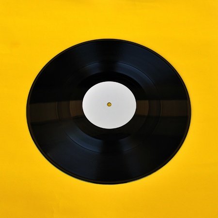 Vinyl record white label promo on yellow background  Music and audio  Stock Photo - 13547407