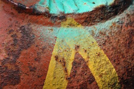 Yellow arrow on peeling rusty metal surface  Abstract iron background texture  photo