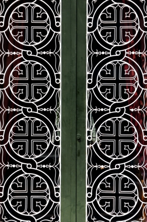 Tangled circles and cross christian religious icon pattern detail on iron church door. photo