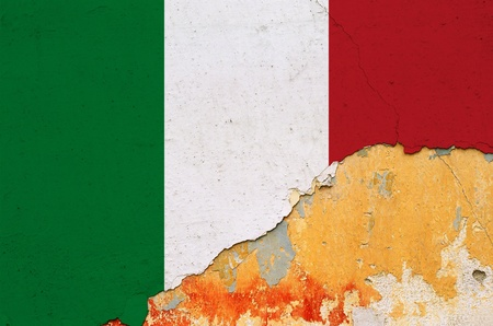 Italian flag painted on cracked smudged wall. Chipped paint grunge background. photo