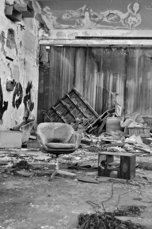 vacant: Dusty chair in abandoned vinyl records pressing factory. Black and white.