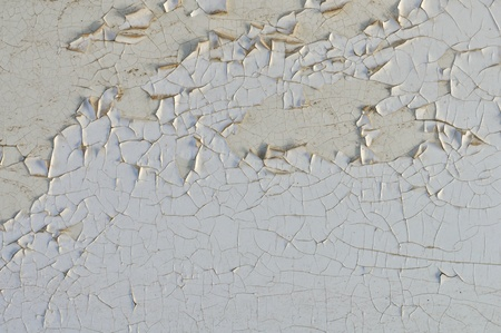 deteriorating: Peeling paint grungy white wall texture. Abstract background.