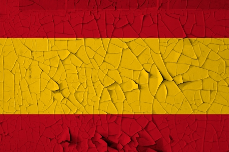 Spanish national flag on peeling paint wall. Weathered grunge background. Stock Photo - 13897383