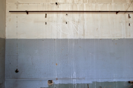 Weathered wall in abandoned industrial interior. Background texture. photo