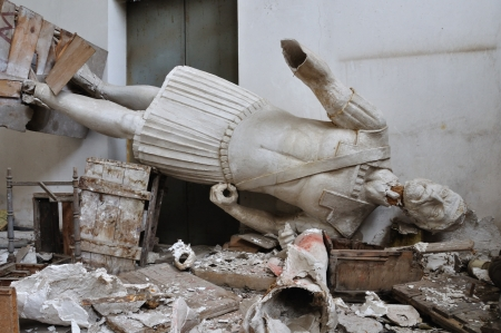 dystopia: ATHENS - FEBRUARY 3: Broken statue gigantic figure ancient god in the abandoned vandalized studio of sculptor Nikolaos Pavlopoulos in Athens Greece, February 3, 2012. Editorial