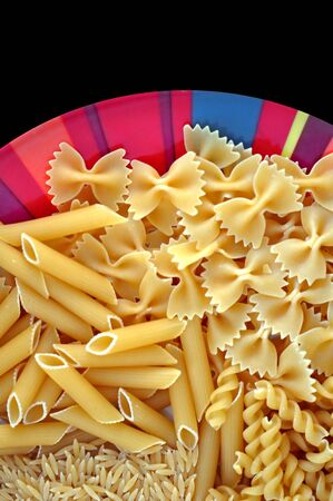 Colorful plate with italian pasta variety. Creative food background. photo