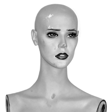 manikin: Weathered plastic mannequin doll head. Black and white.