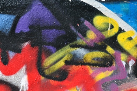 Smudged spray paint detail on graffiti covered wall. Stock Photo - 15625619