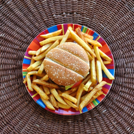 Cheeseburger and french fries dish. Fast food background. photo
