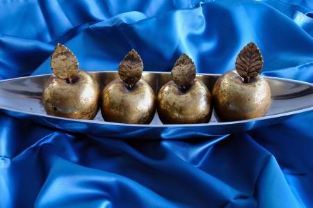 Golden apples on blue background. Christmas symbol vintage decorative objects. Stock Photo - 16185910