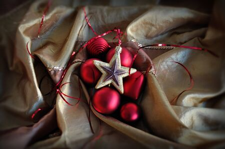 Red baubles and golden star. Christmas ornaments background. photo