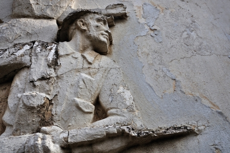 ATHENS - FEBRUARY 3  Entablature of soldier with broken bayonet on weathered wall exterior at the abandoned house of sculptor Nikolaos Pavlopoulos in Athens Greece, February 3, 2012  Stock Photo - 16744781