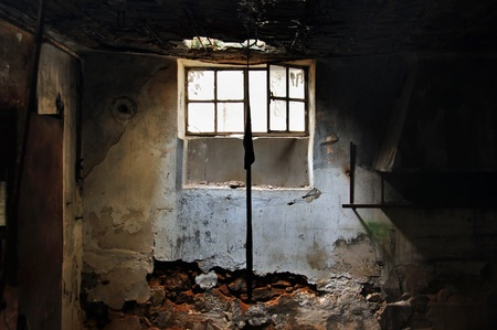 abandoned factory: Sunlight through the broken window of an abandoned factory  Stock Photo