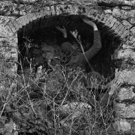 obscured: Obscured figures in arched abandoned structure. Double exposure black and white.
