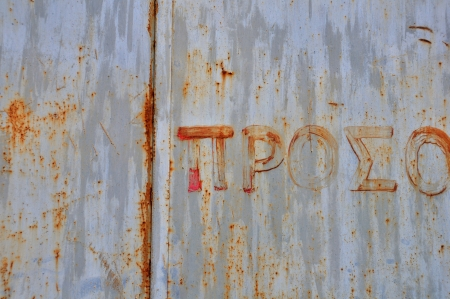 Rusty metal surface with hand painted typography. Abstract grunge background. Stock Photo - 17932521