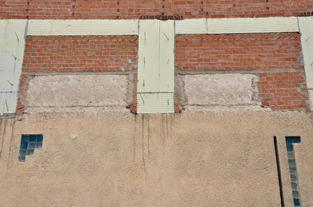 Brick wall and insulation material background. Building under construction. photo