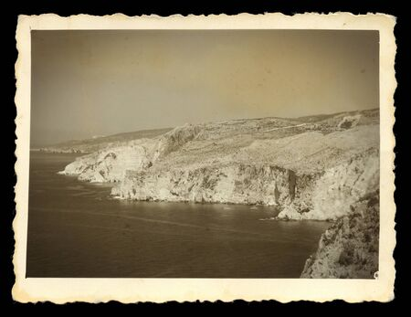 coastal erosion: Old photograph of steep sea cliffs rocky headlands  Vintage style digital composite  Stock Photo